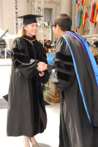 Karin Gaudet-Asmus Accepting Her Diploma From Berkeley Law's New Dean Melissa Murray